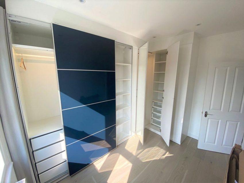 Sliding wardrobe doors onto corner wardrobe doors open